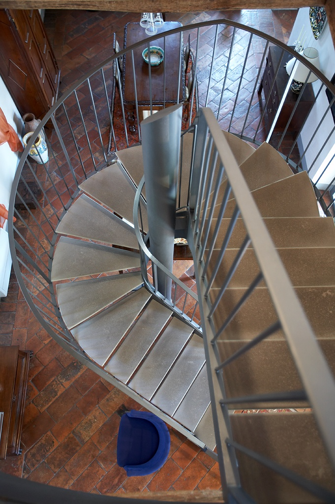 iron and stone staircase for a renovation of a farhouse