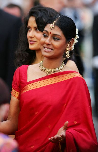 Nandita Das  simple red, clean border across the shoulder, minimalist Teeka.