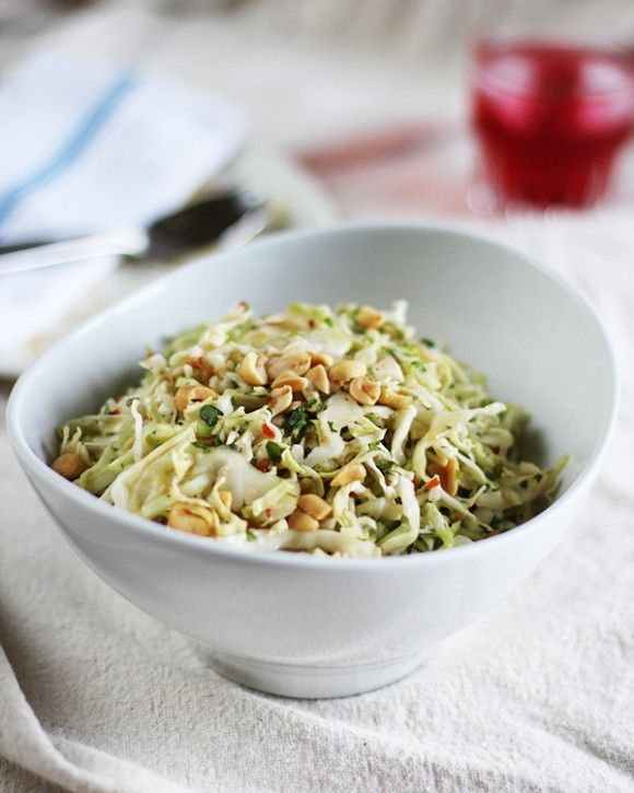 GINGERY CABBAGE SLAW WITH SPICY LIME:  1 pound green cabbage (about 1/2 small head) 1/4 tsp salt,   2 tsp ginger,   2 tbs lime juice,   1 tsp soy sauce or tamari,   1 tsp - 1 tbs chili paste (like sambal oelek), depending on spice preference 1 tbs oil,   3 tbs cilantro,  1/4 c nuts,