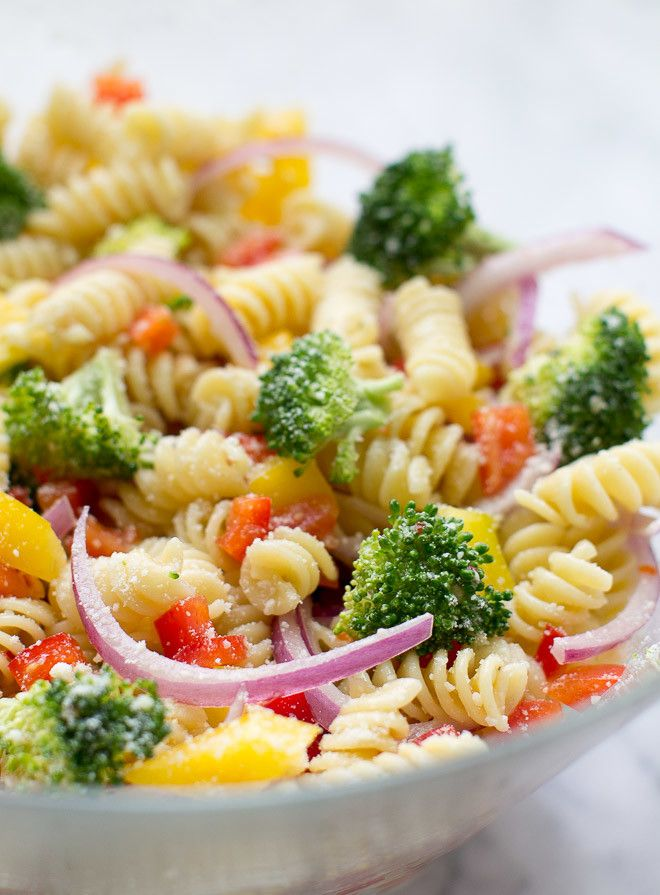 Easy Rotini Pasta Salad with broccoli, colorful peppers, zesty Italian dressing and Parmesan cheese.