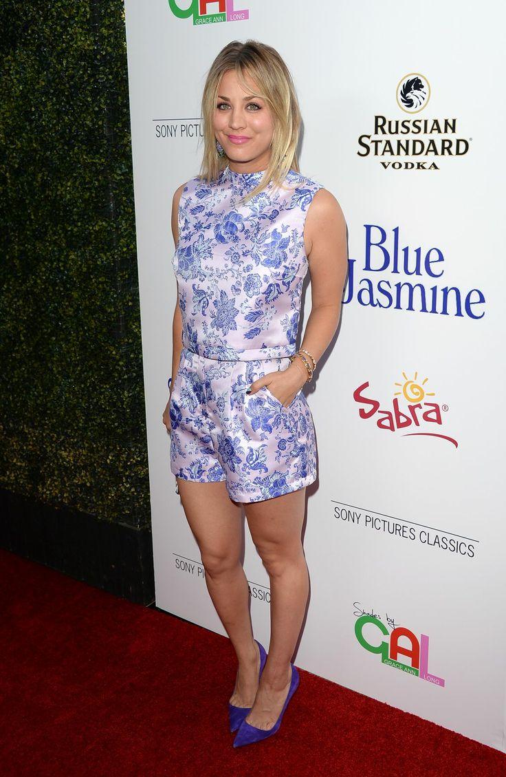 Kaley Cuoco.. blue floral Zimmermann playsuit, Manolo Blahnik blue suede pumps, Jimmy Choo clutch, and Dannijo jewels..