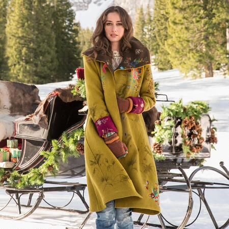 LEGENDS OF THE FOREST COAT  Boiled wool coat takes embellishment to a new level with shadowed poppies and vibrant embroidered blooms. Fully lined. On-seam pockets. Leather buckle keeps hood snug. Merino wool. About 450 euro. Robert Redford's Sundance Catalog.