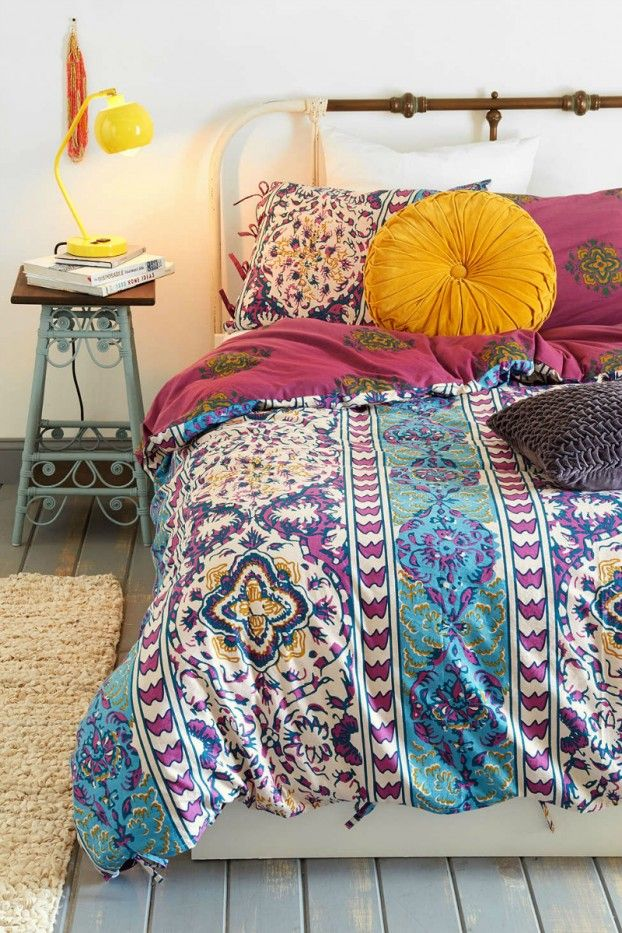 Love the colors in this bohemian bedroom. (so I can search it later: round yellow pillow, aqua night stand, pink, purple, turquoise, boho)