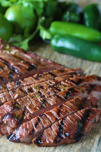 Marinated flank steak is grilled to perfection for the best Authentic Carne Asada recipe. This tender, grilled meat is full of authentic Mexican flavor.