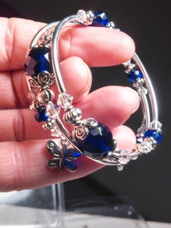 Memory wire bracelet.... Cobalt blue...lllllove  these swirled bead caps