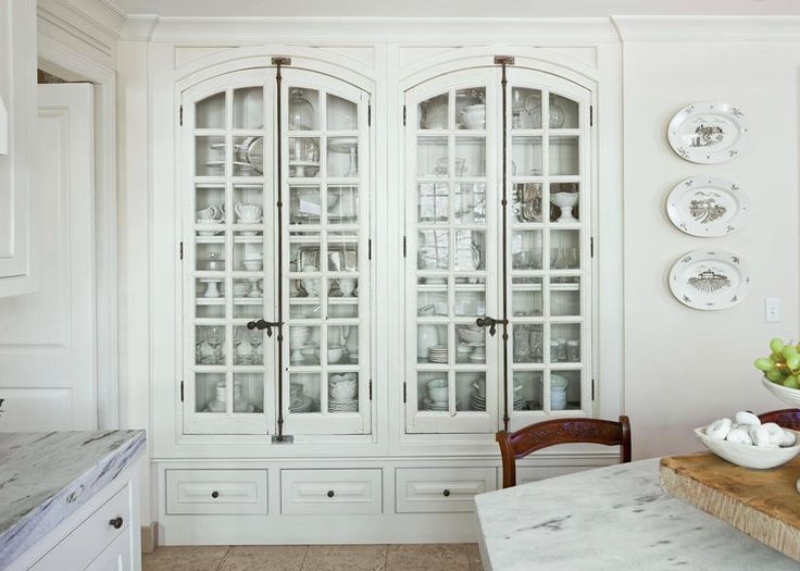 From Southern Living – photo: Laurey W. Glenn - fabulous built in cabinet in this gorgeous kitchen - I want these old white doors with cremone bolts! Oh, and everything inside too!