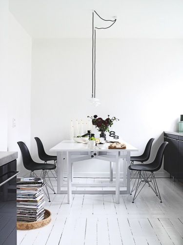 white floors and black chairs