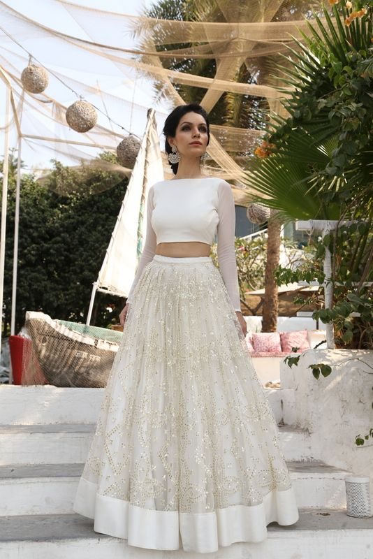 White thread work and sequins lehenga with white crop top.