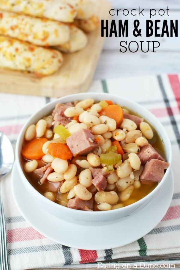 Try this hearty ham and bean soup crock pot recipe. Slow Cooker ham and bean soup is quick and easy. Crock pot ham and beans will be a hit with the family! #crockpot #soup #ham