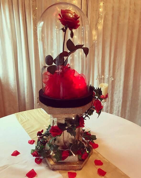 A Beauty & The Beast inspired centrepiece with red roses, perfect for your wedding or party.  Available to hire from Make It Special Events