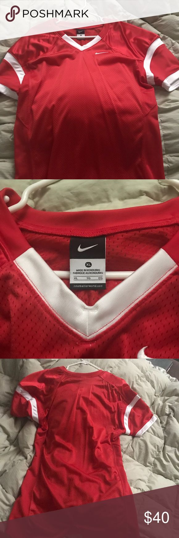 Red Nike Jersey Basic red and white football jersey. Anyone can wear it  Men can use it for football Also women can wear it as an oversized dress with some nice shoes  In new condition  I only wore it once with some white airforce 1s Nike Shirts Tees - Short Sleeve