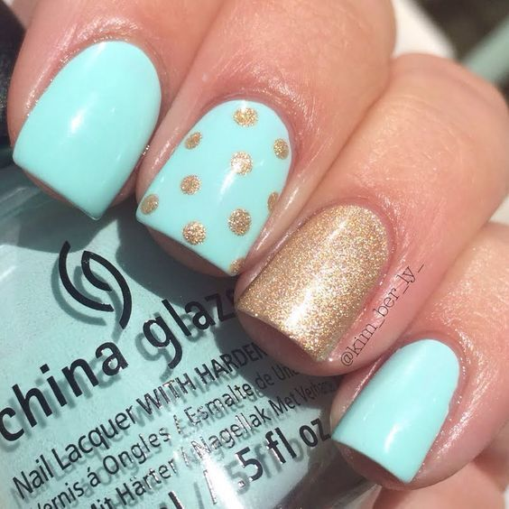 Easy on the eyes, pastel blue nail polish is complemented by a gorgeous sparkling polka dotted gold for accent. Recreate this manicure with the help of these products used.:
