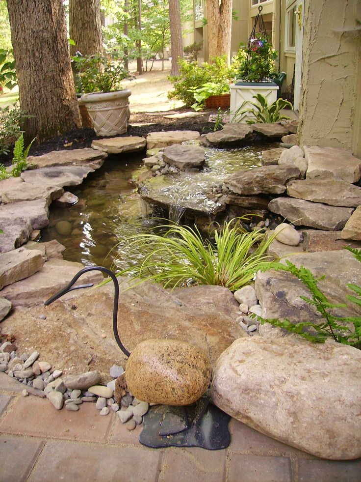 I love the stone duck!      'Like' Outdoor Dreams on Facebook for access to our complete portfolio and helpful articles on improving your landscape.      http://www.facebook.com/OutdoorDreams?sk=app_190322544333196