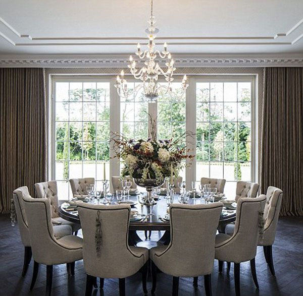 Furze Croft in Weybridge, Surrey. Acres Neo-Palladian Mansion by Consero  London. The dining room seats 18 people and is perfect for dinner parties.