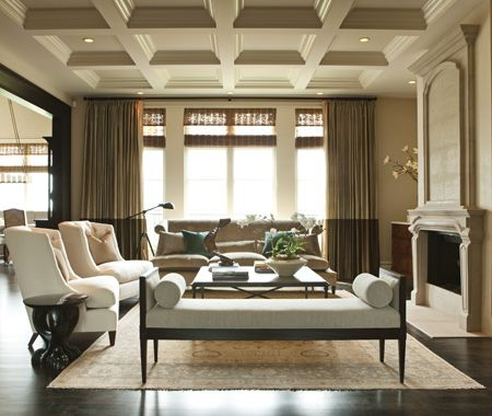 In this luxurious living room, designer Nam Dang-Mitchell created a European-inspired oasis with a sophisticated, classic look. A low, open bench is the first thing you see upon entering the room. It