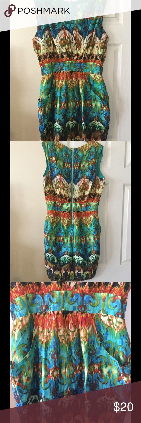 Colorful guess dress Gorgeous colorful dress by guess. Size 10. Has pockets on the th sides as seen in picture 3. Zips up in the back as seen in picture 2. Preloved euc Guess Dresses
