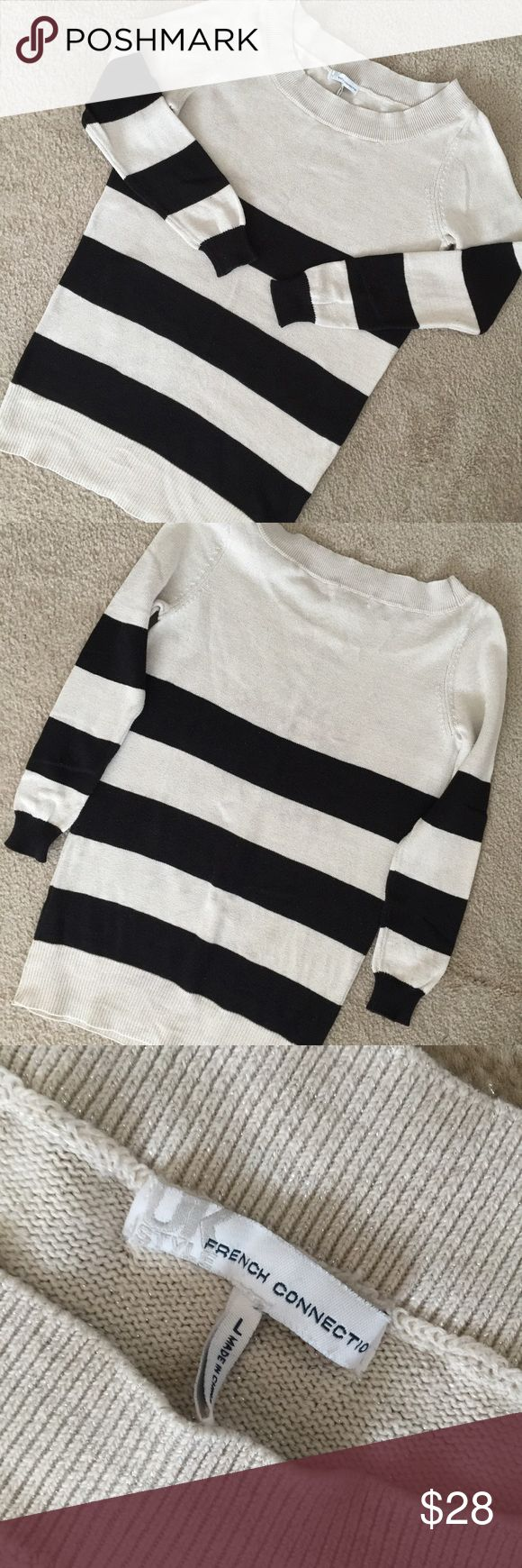 """French Connection Striped Tunic Sweater Size Large Pretty tunic sweater from French Connection! High quality knit, tan and black striped, boat-neck, tunic sweater. The tan part of the sweater has pretty silver flecks interwoven into the knit. Great condition-minor pilling under the arms. 22"""" from shoulder to hem; 19.5"""" from armpit to armpit. Sleeves are 26"""" long. Perfect with leggings and booties! French Connection Sweaters"""