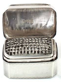 The graters were made on a great variety of styles and shapes and were in use throughout the first half of the Victorian era. The most frequent shape was the rectangular form with hinged cover and base, but also the barrel shape unscrewing at the center and with a silver rimmed metal grater was highly popular.