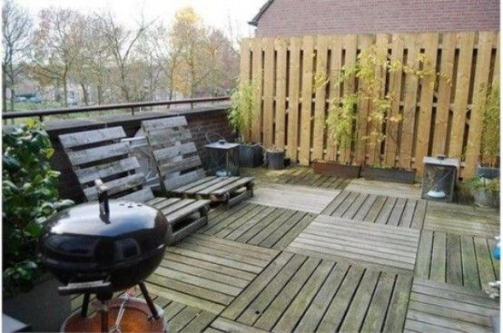 repurposed palettes : terrace decking and privacy fence