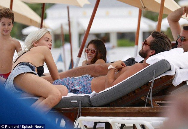 Close: At one point the pretty blonde was seen leaning her arm over Scott's legs as he lay...