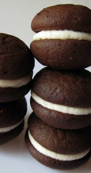 Recipe for Mini Oreo Whoopie Pies - Here is a yummy play on the classic American cookie, the Oreo. Creamy vanilla filling between two cakey, chocolatey cookies...so good!