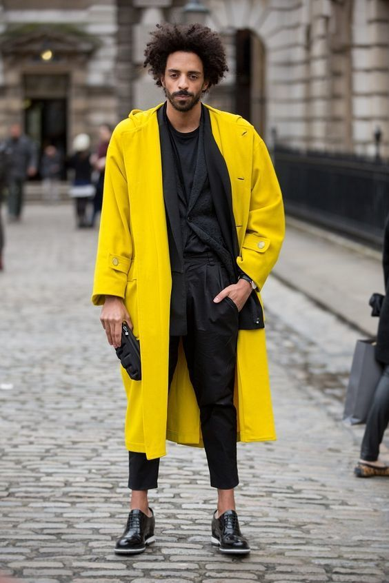 Reach for a yellow trenchcoat and black chinos for drinks after work. Turn your sartorial beast mode on and opt for a pair of black leather oxford shoes.   Shop this look on Lookastic: https://lookastic.com/men/looks/trenchcoat-blazer-crew-neck-t-shirt/18285   — Black Crew-neck T-shirt  — Black Blazer  — Black Leather Watch  — Black Chinos  — Black Leather Oxford Shoes  — Yellow Trenchcoat