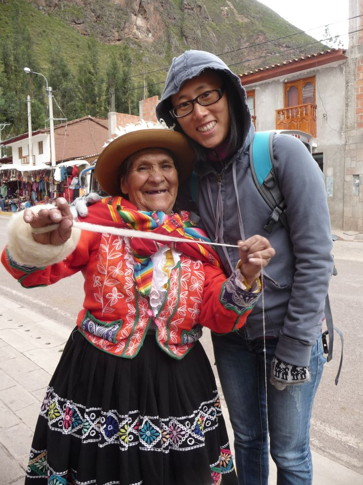 Yeji meets little old smiley wool lady. Pisac, Peru.