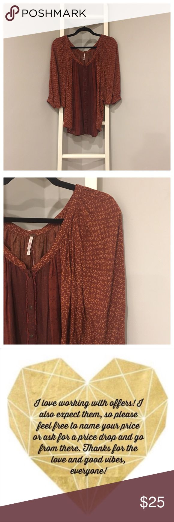 Free People Burgundy Boho Chic Dolman Sleeve Top S Free People Burgundy and terra-cotta/burnt orange Dolman Sleeve batwing Top with button down front. Lots of cute boho chic detailing to this top! Love the way Free people makes their tops! This is very unique and has lots of nice detailing on it to make it a stand out top. I love the way Dolman sleeves hang on people, it's a very flattering and elegant look that would look great tucked into a skirt among other things. Size S Excellent…