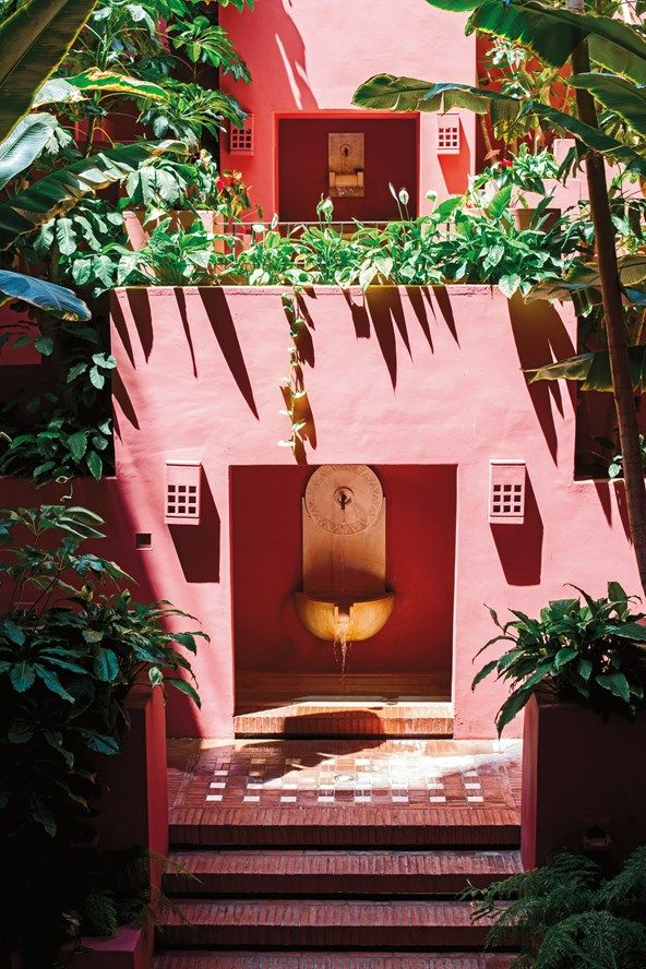 Pink walls and lush greenery surround a courtyard with a Moroccan feel, at the Ritz-Carlton, Abama hotel in Tenerife, Canary Islands, Spain. Photo by Ana Lui