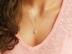 We are thrilled to add this lovely layered set of two necklaces by Simple and Layered to our handcrafted collection. If you love the ocean, then you'll love this layered necklace set. It features two