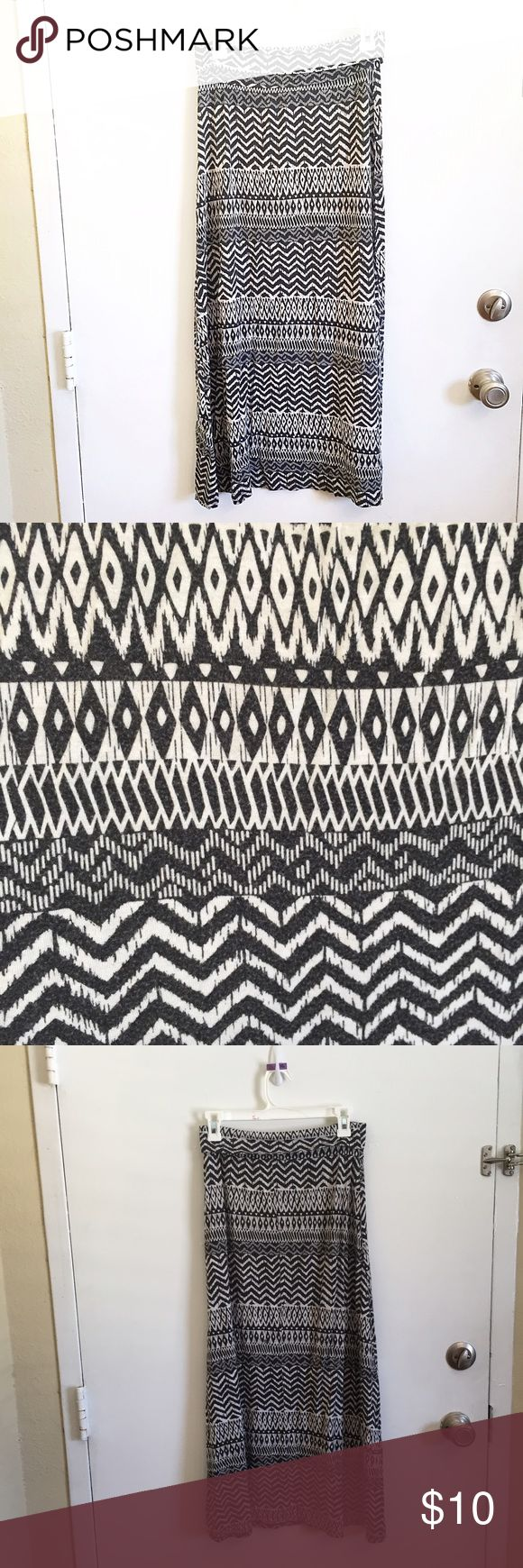 """Black & White Tribal Maxi Skirt Black and white tribal maxi skirt. Size tag is worn off but the waist measures 14"""" flat and unstretched. Does have some fading and piling. Waistband can be folded over or worn high waisted.  #blackandwhite #tribal #aztec #maxi #skirt #maxiskirt #punkydoodle  No modeling Smoke and pet free home I do discount bundles Skirts Maxi"""