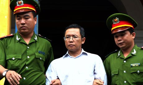 Pham Minh Hoang, a French-Vietnamese blogger and lecturer, is led out from the Ho Chi Minh City courtroom after he was jailed for three years.