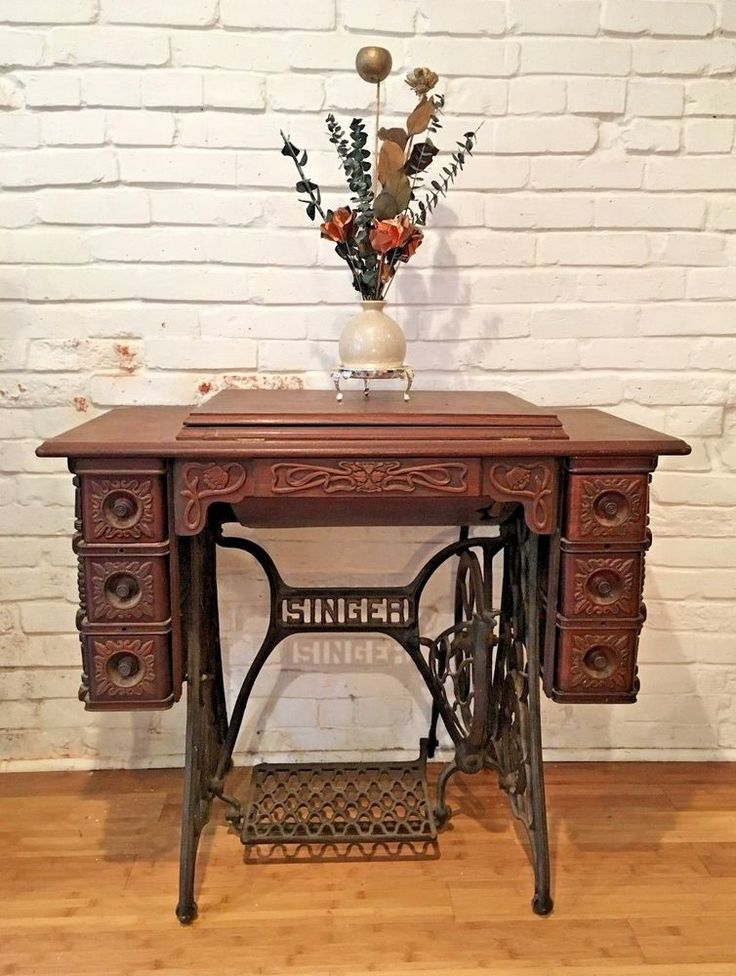 Beautiful Ornate Antique Sewing Table #Singer Use this ornate piece as a unique console table, desk, or vanity in your home! It has 7 drawers to use for storing your small items. This piece will make a beautiful addition to any room.