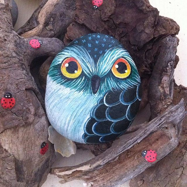 painted owl on a rock