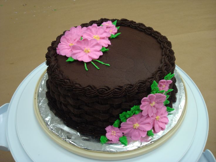 - Royal Icing flowers on chocolate buttercream with basket weave.