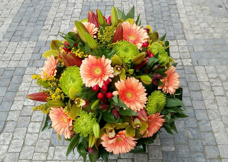 A big bouquet of gerberas, lilly, shamrock, cymbidium, solidago, alstroemeria, hypericum