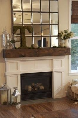love the mirror!!  and the contrast with the white fireplace and brown mantel and floors