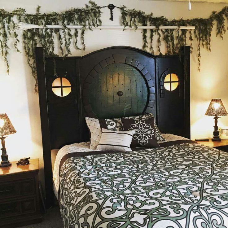 Hobbit door headboard. Love the curtain rod and greenery with the key. Headboard should be a really dark brown though