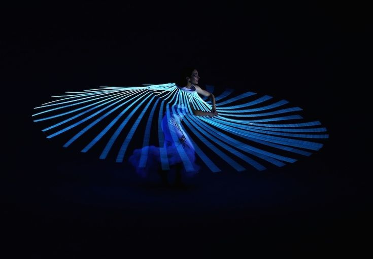 A performer dances during the opening ceremonies.