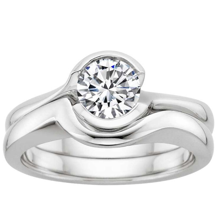 Brilliant Earth Cascade Matched diamond engagement ring and wedding band, available in recycled platinum, white, yellow or rose gold, set with an ethically sourced diamond that is fully traceable back to its original source.