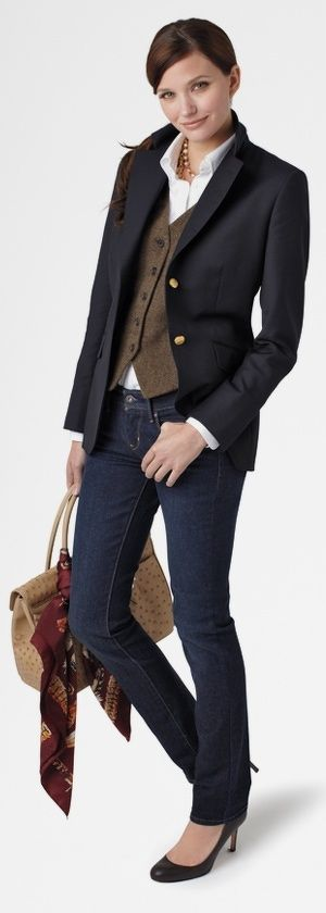 Classic navy blazer with brass buttons, button down brown vest, white cotton shirt and bootcut bluejeans with roundtoe pumps. Very Ralph Lauren!