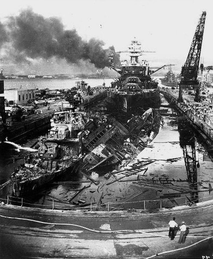The wreckage at Pearl Harbor was devastating. The USS Downes and USS Cassin are shown here soon after the end of the Japanese air attack. Cassin capsized onto the Downes.