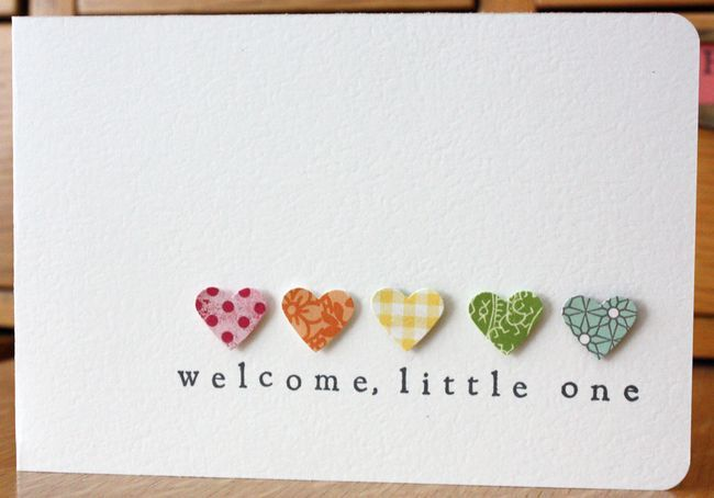 Adorable and simple baby card. I am seeing hearts in shades of blue or pink or yellow...