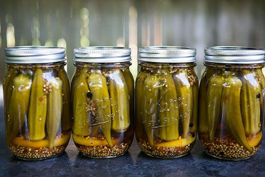 Pickled Okra ~ They're crunchy, not slimy! Lightly spicy homemade pickled okra, with cider vinegar, lemon, garlic, and spices. Easy to make. ~ SimplyRecipes.com