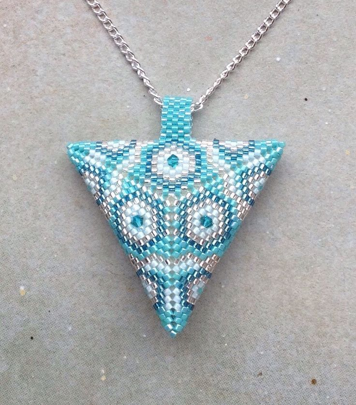 Turquoise and Silver Delica and Swarovski Crystal peyote triangle pendant necklace UK seller by SimplyTheBead on Etsy https://www.etsy.com/listing/242692296/turquoise-and-silver-delica-and
