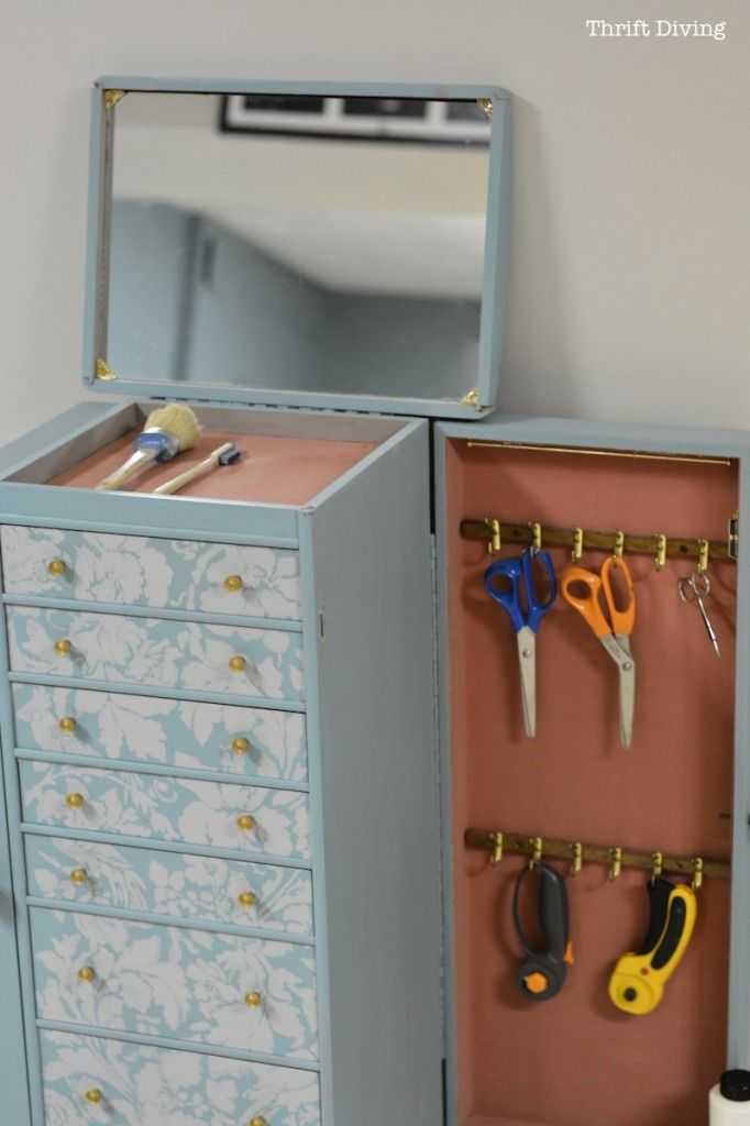 Genius! Repurpose jewelry armoire into a supplies cabinet!!!!!