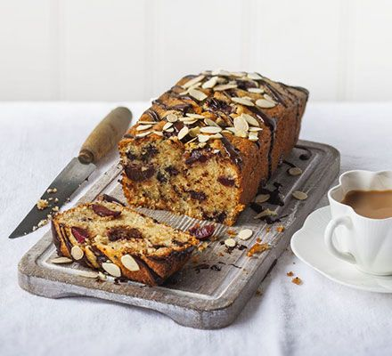 Chocolate cherry Bakewell cake. An irresistible almond sponge, studded with juicy cherries and chocolate chunks, that'll keep in your cake tin for a few days - if it lasts that long!