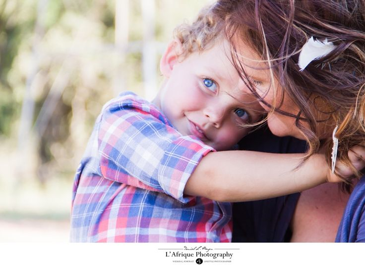 Photo of blue eyed boy with his mum at backpackers farm in Cullinan photographer Daniel L Meyer by L'Afrique Photography