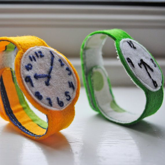 Felt watch.  Should be an easy DIY for a lil kiddo who is obsessed with clocks!