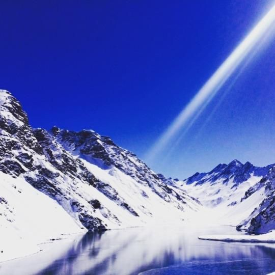 """The first thing you notice when you arrive at Portillo is the sky and the fact that it is both empty and the perfect shade of blue. A groovy yellow resort sits in the middle of the Andes. Some skiers refer to this resort, perched at an elevation of 9,500 feet in the Andes Mountains, as """"Chile Mignon"""